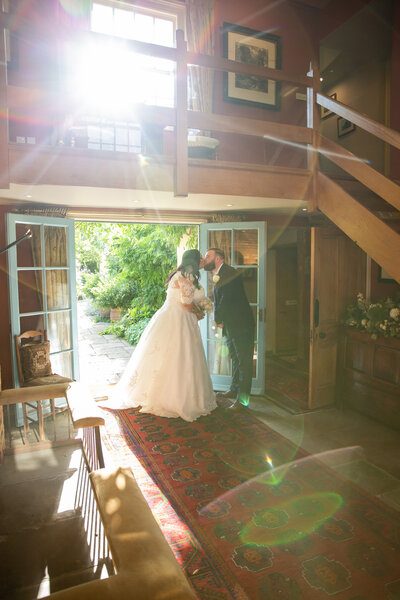 Bride and Groom kissing in golden hour at South Farm