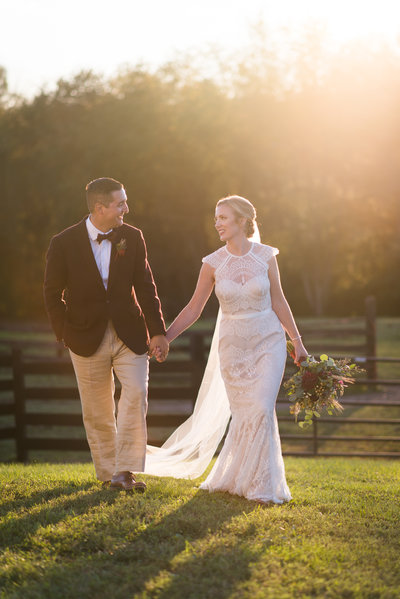 bride and groom at sunset at hermitage hill barn wedding by virignia wedding photographer