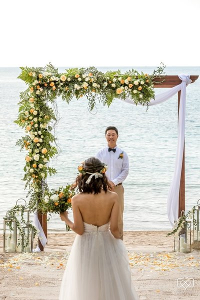 Couple and wedding arch
