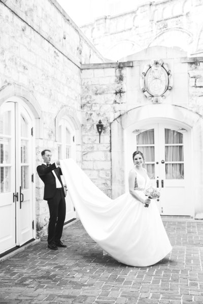 austin wedding photographer chateau bellevue bride groom looks under dress