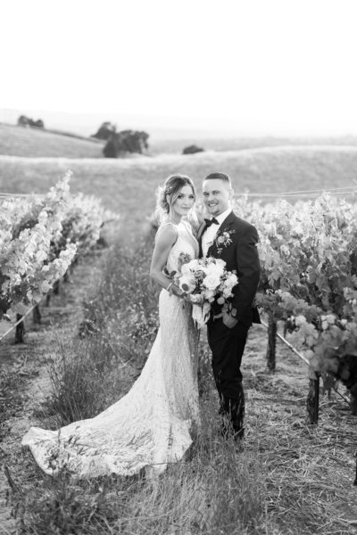 Bride and groom in vineyards at Livermore wedding