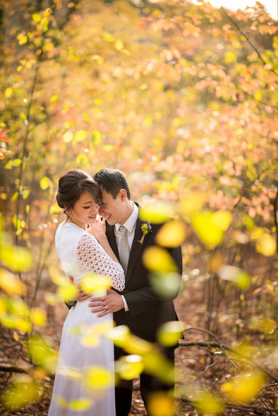 Bride and Groom embracing in fall foliage Boston