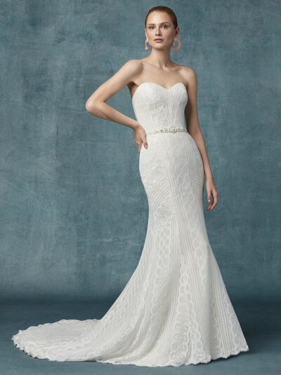 Strapless Sheath Bridal Gown. This is geometric lace for your Vie Bohème. Easy-breezy comfort for ceremony and reception. A strapless sheath bridal gown for your happily ever after.