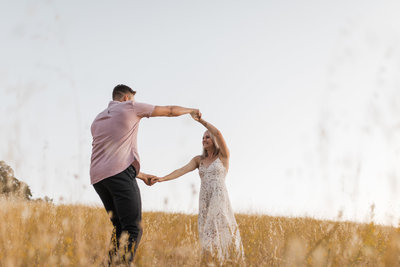 man and woman dancing in field