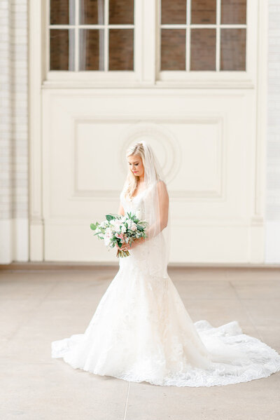 bride holding her bouquet at dallas union station venue by dallas wedding photographer catie ann photography