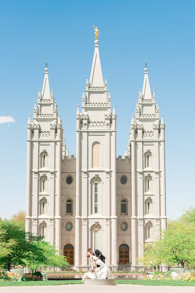 Bride and groom in front of the salt lake temple