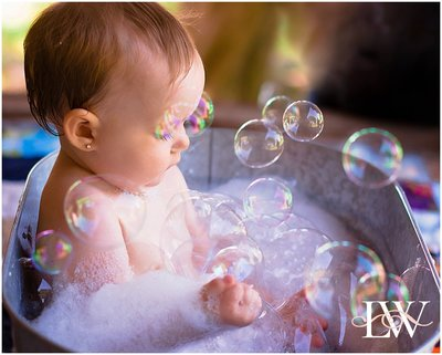 BABY IN A TUB WITH BUBBLES  FAMILY PORTRAI TAKEN BY LAURA WALTER PHOTOGRAPHY IN CURRITUCK NORTH CAROLINA