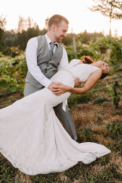 laughing couple at sunset at washington vineyard outdoor wedding