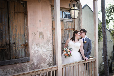 Bride and Groom on balcony at Race & Religious, New Orleans Wedding