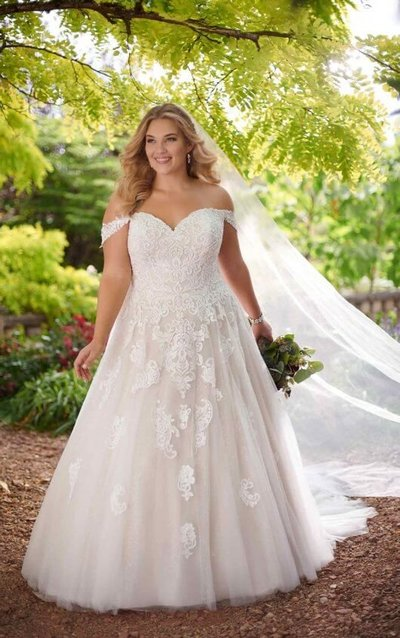 Plus size lace bridal gown with straps