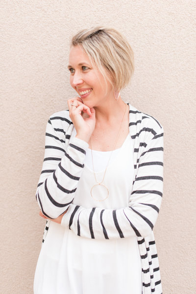 Headshot of Texas Photographer wearing striped cardigan
