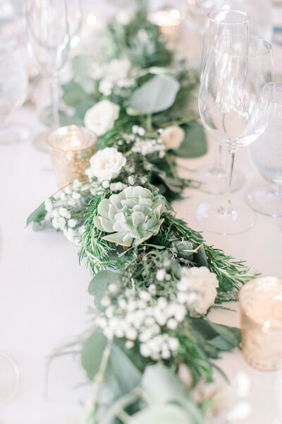 white table with succulents and white flowers
