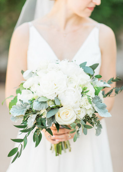 bride outdoors holding wedding bouquet