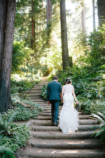 Couple on stairs in chapel at Nestldown among redwoods