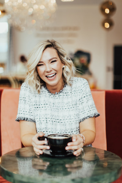 woman holding mug and smiling