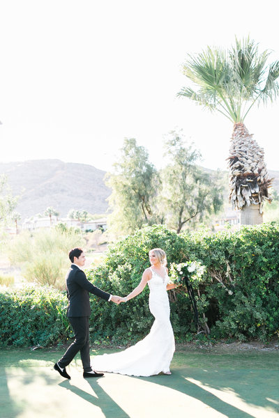 bride and groom in a grass field at Red Rock Country Club in Las Vegas