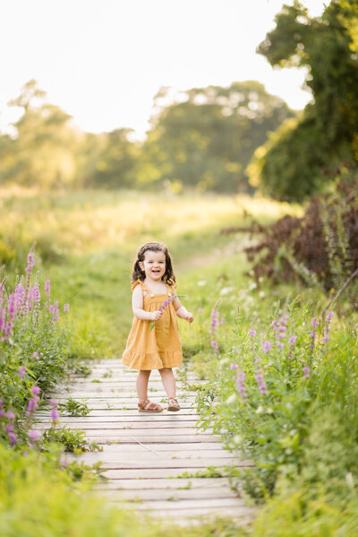 little girl twirling in a dress during family session