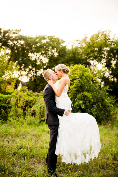 Bride and groom with veil at nature preserve