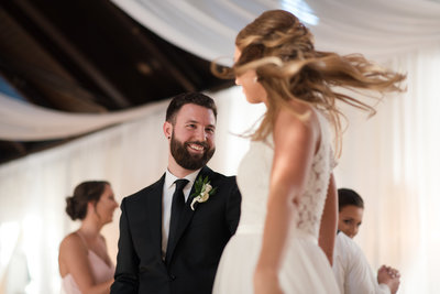 groom dancing with bride during wedding reception at womans club of portsmouth wedding by hampton roads  photographer