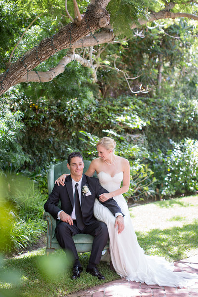 Bride and Groom sitting on chair at their wedding at La Jolla Women's club