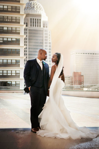 African American wedding on top of the Galt House Hotel overlooking Louisville skyline