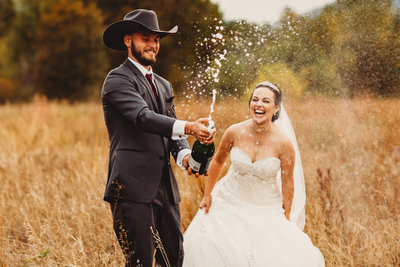 cowboy kisses bride on forehead