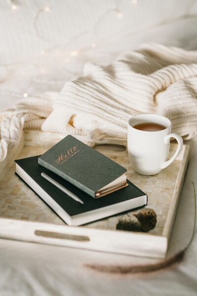 photo-of-cup-beside-books-4068029