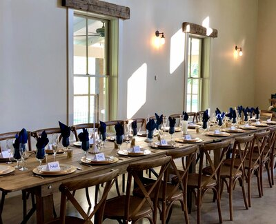 Seating with wooden banquet chairs and place settings
