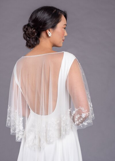 Photo link to more details about the Dolores wedding dress with detachable capelet
