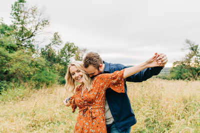 Virginia Wedding Photographer, couple standing with their arms out wide in a field