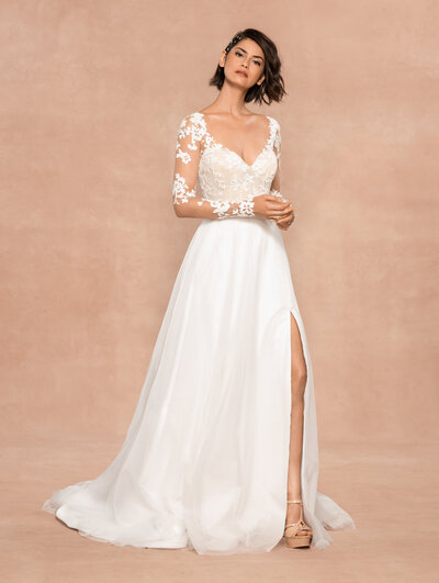 Blush by Hayley Paige bridal gown - Frosted Lily embroidered A-line gown, sweetheart neckline with illusion long sleeves and nude lining, keyhole back with floral appliqué, flowing skirt of layered net and tulle with slit.