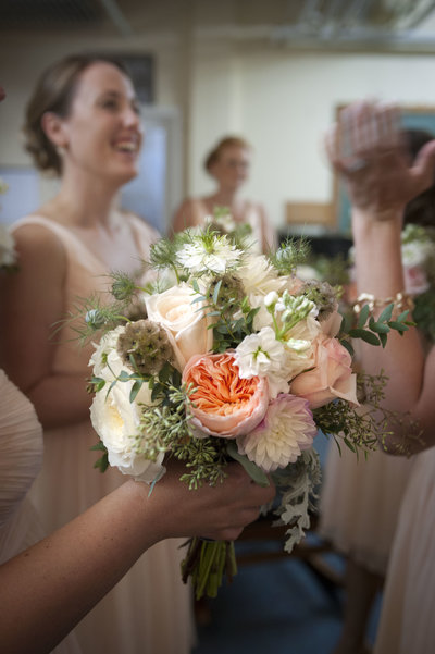 Beautiful floral bouquet held by bridesmaids at wedding in Portland, Maine