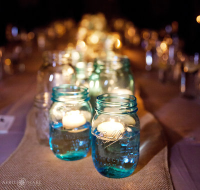 Blue-and-White-Mason-Jars-with-Floating-Candles-Lit-at-an-Evening-Reception-From-Cowboy-Gourmet-Events-in-Vail-Colorado