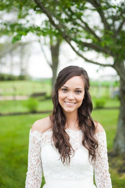Outdoor spring bridal portrait with trees in Kentucky