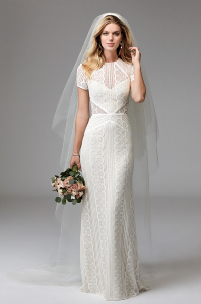 For the bride who loves a polished look, Lenora is the answer. Boasting our classic Circle Lace, Lenora features a high neckline with cap sleeves. Thoughtfully-placed trim and cutouts contour the body while the open keyhole back adds a modern twist.
