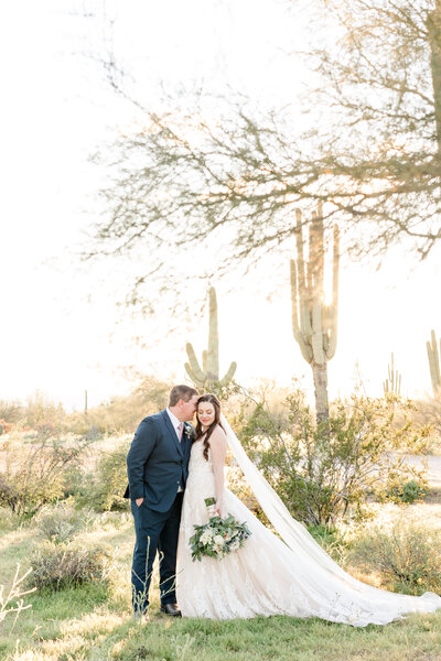 Bride and groom during desert sunset photos