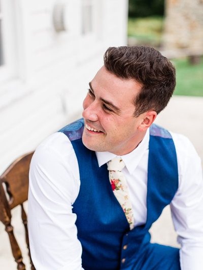 Close up of handsome groom in blue suit vest