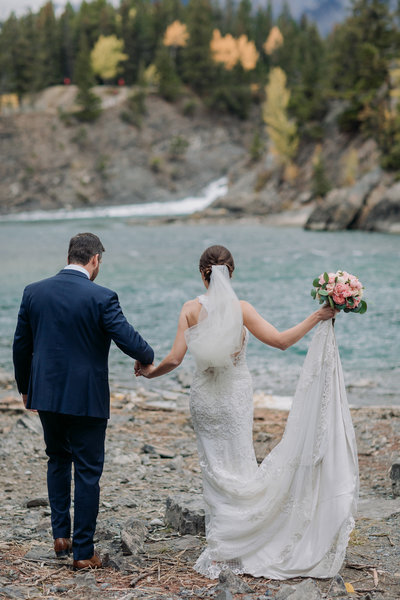 banff wedding  bride groom walking bow falls