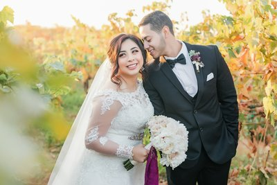 Bakersfield Wedding photographer Marianne Lucas wedding photo. Film photo, greenery bouquet, Oaks room, picture of a sweet heart table with glass surrounding the back of them.