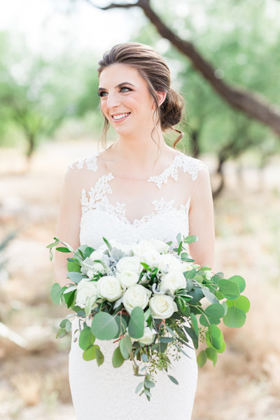 Brial portrait with bouquet by Alexis Grace and dress from J Bridal