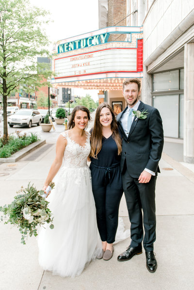 Bride and Groom in wedding photos at the Kentucky Theater in downtown Lexington KY