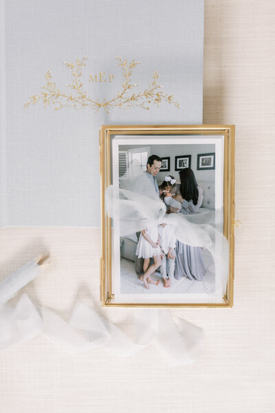 Fine art photo album and prints in gold box with custom ribbon.