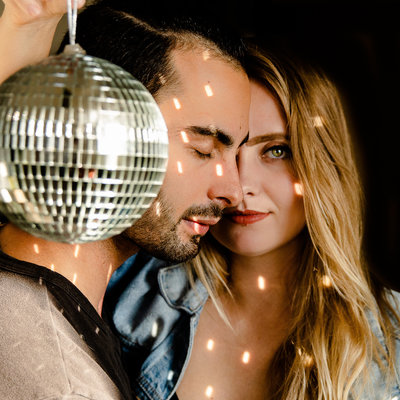 bree and stephen take self portraits with a disco ball