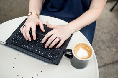 Hands on keyboard with coffee