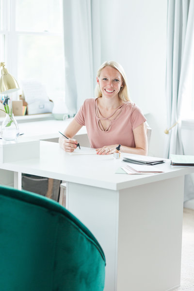 Katy Ackerman, calligrapher, in her office