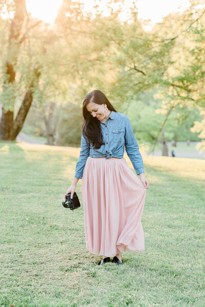 Dolly of Dolly DeLong Photography New Headshots wearing a long pink skirt and denim shirt a Nashville Family Photographer