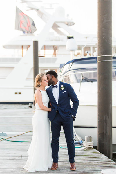 Bride & Groom share a moment on the docks at the Bohlin