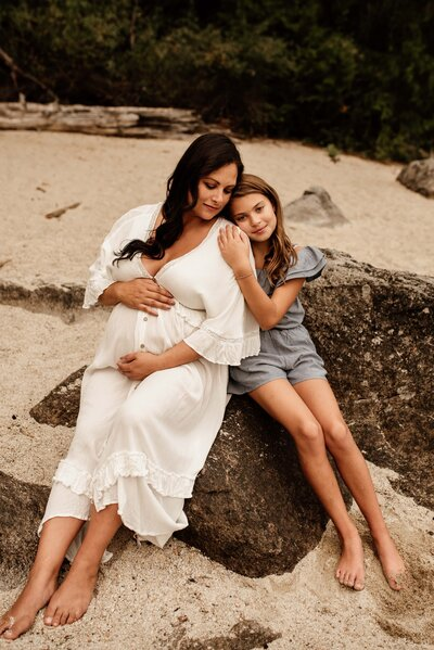 beach mom and daughter maternity  session pregnant mom