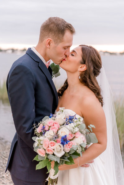 intimate kiss during portraits for a wedding in connecticut