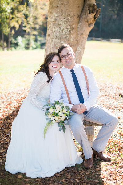 Wedding Photography, Bride and Groom sitting under a tree together
